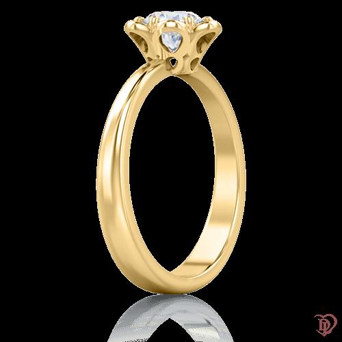 <p>Каблучка в жовтому золоті зі вставками: діаманти</p>  0005764