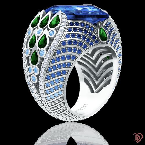 <p>Каблучка в білому золоті зі вставками: діаманти, сапфіри, топази, смарагди</p>  <p>Коктейльна каблучка Едем: Храм Сонця в оправі з благородного білого металу (золота, платини, паладію) з глибокими синіми сапфірами, небесно-блакитними Ice Blue топазами, насиченими зеленими смарагдами і сяючими міріадами діамантів - мрія будь-якої дівчини. Зачаровуючий дорогоцінний калейдоскоп з унікальним дизайном, неодмінно виділить свою володарку, відобразить її характер, створить шикарний образ, гідний світської левиці</p>  0008863