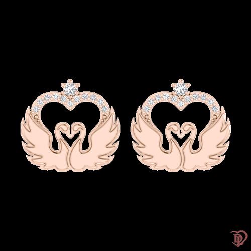 <p>Сережки в рожевому золоті зі вставками: діаманти</p>  <p>Сережки-гвоздики в рожевому золоті з розсипом діамантів колекції Вірність: Відродження, створені для тих, хто цінує свою індивідуальність. Плавні золоті лінії і сяючі діаманти притягують погляди, створюють неповторний образ, дарують життєрадісний настрій. Чуттєво і ніжно золоті сережки розкажуть про тонкий смак своєї власниці.</p>  0021147