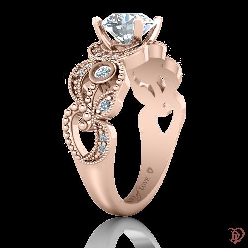 <p>Каблучка в рожевому золоті зі вставками: сапфіри, діаманти</p>  0022047